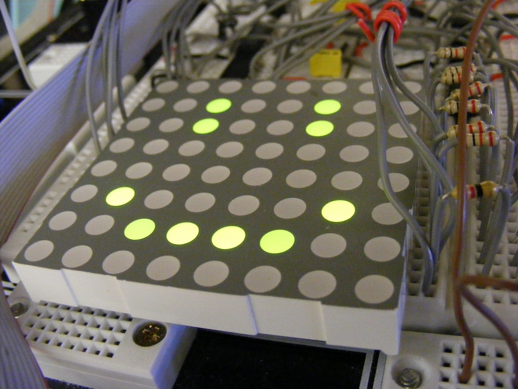 8x8 LED dot matrix display showing a smiley face.